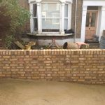 Reconstructed yellow brick wall in a front garden | Bricklayers in London